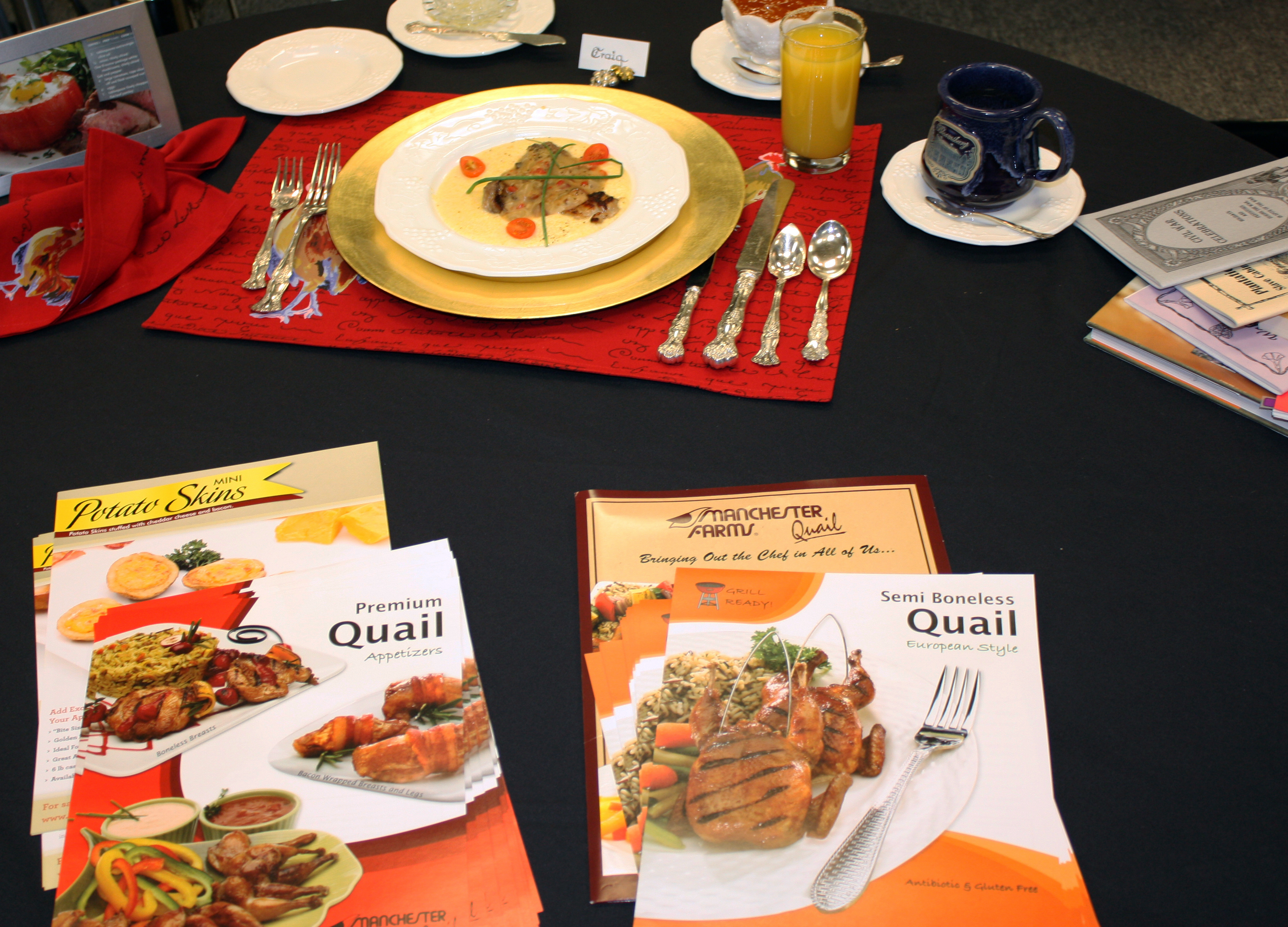 Perfect table setting featuring a plate of quail and grits.